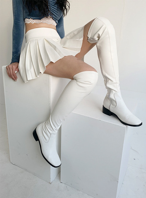 knee-high white boots